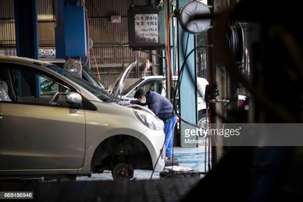 Man working in automobile restoration workshop