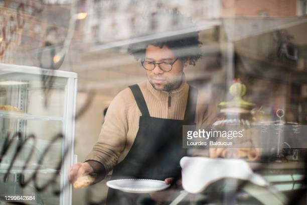 man working in coffee shop - 35 39 years stock pictures, royalty-free photos & images