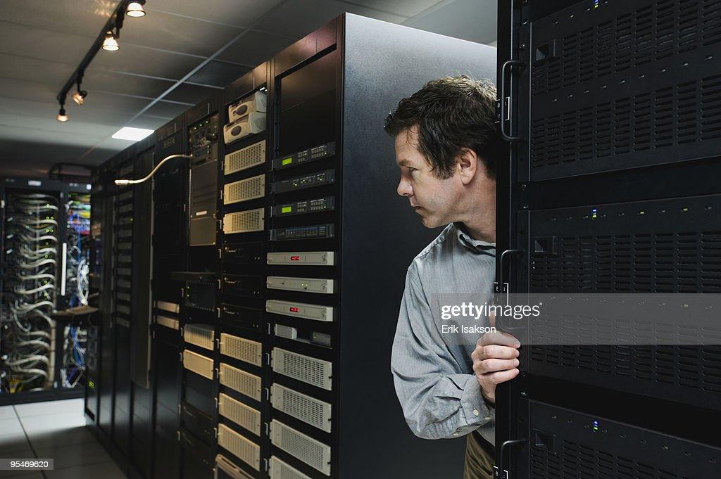 Man working in data center : Stock Photo