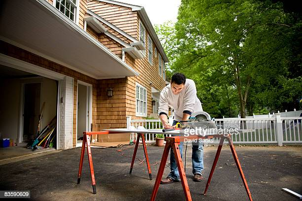Man working in driveway