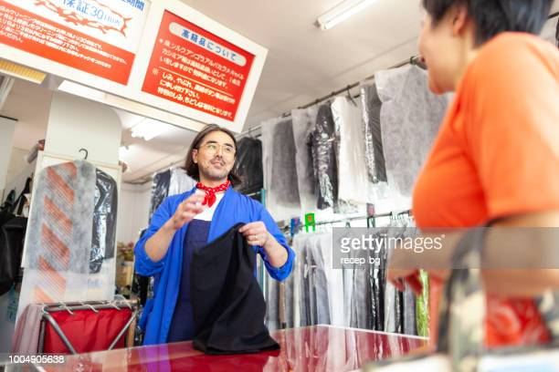 Man working in dry cleaning shop