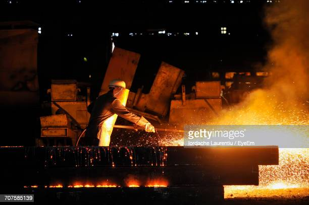 man working in factory - steelmaking stock photos and pictures