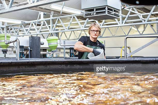 Man working in fish farm