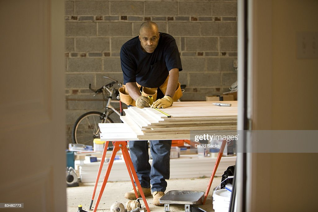 Man working in garage : Stock Photo