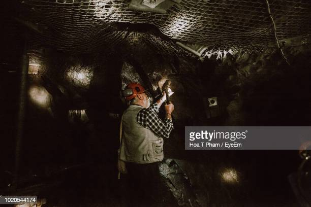 man working in gold mine cave - bendigo stock pictures, royalty-free photos & images