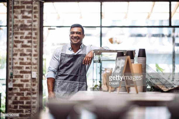 Man working in his own cafe
