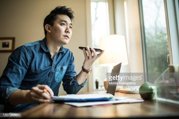man (early 30s) working in home office - the image bank stock pictures, royalty-free photos & images
