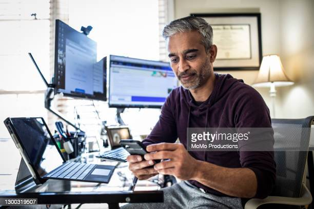 man working in home office - business stock pictures, royalty-free photos & images