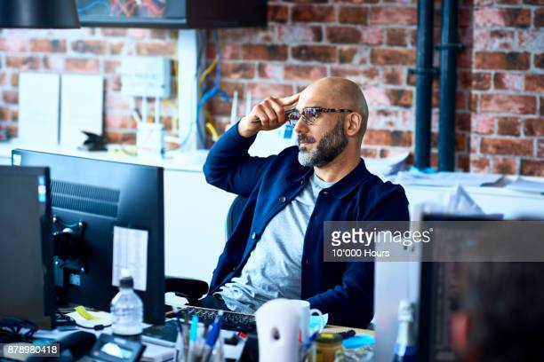 man working in modern office - man made structure stock pictures, royalty-free photos & images