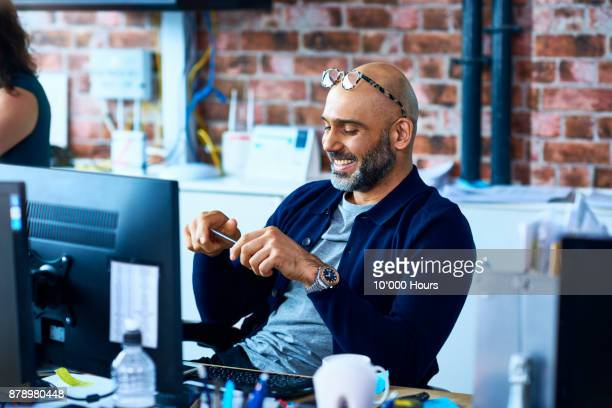 man working in modern office - balding stock pictures, royalty-free photos & images