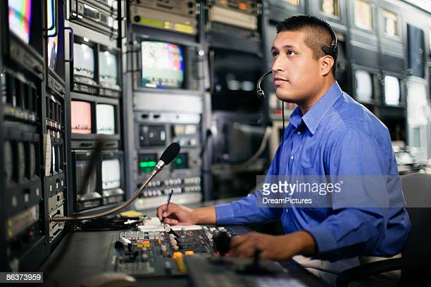Man working in newsroom