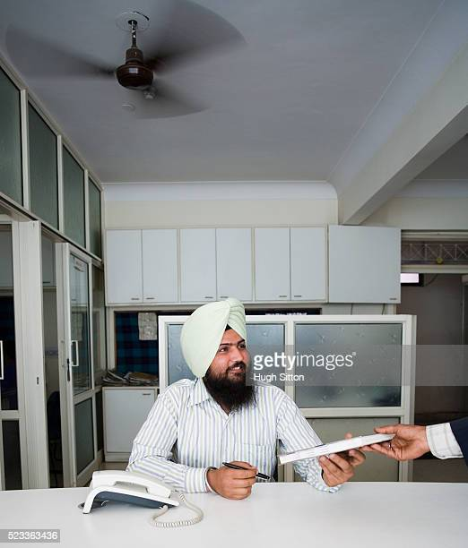 man working in office - hugh sitton india stock pictures, royalty-free photos & images
