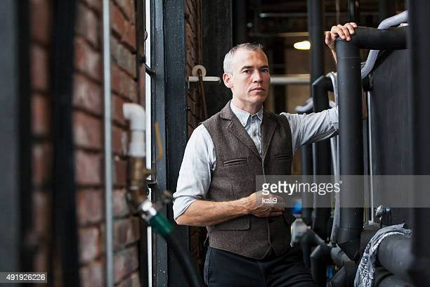 man working in old distillery - waistcoat stock photos and pictures