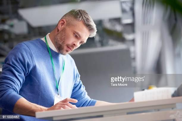 man working in open plan office
