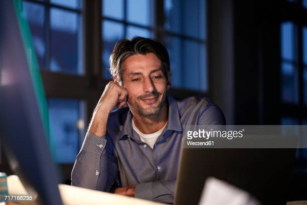 man working late in office - one man only stock pictures, royalty-free photos & images