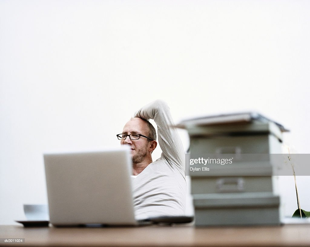Man Working on a Laptop at Home : Stock Photo