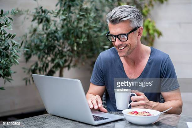 man working on a laptop - handsome people stock pictures, royalty-free photos & images