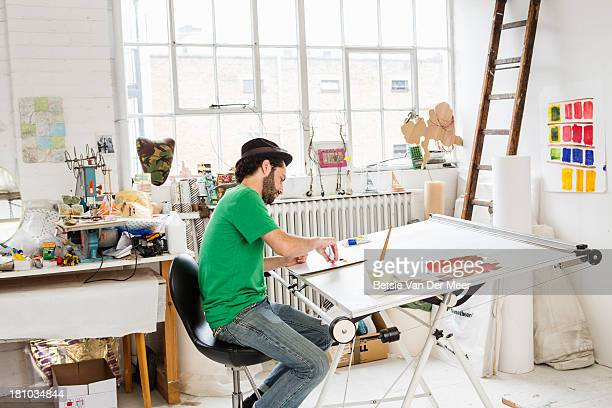 Man working on architect table in art studio