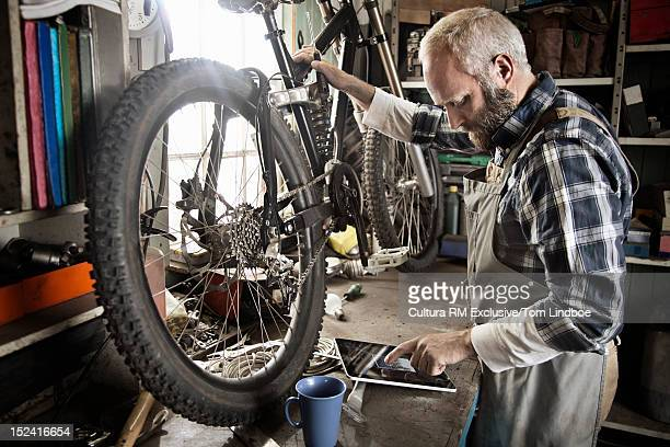 Man working on bicycle in workshop