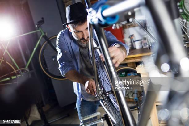 Man working on bicycle in workshop