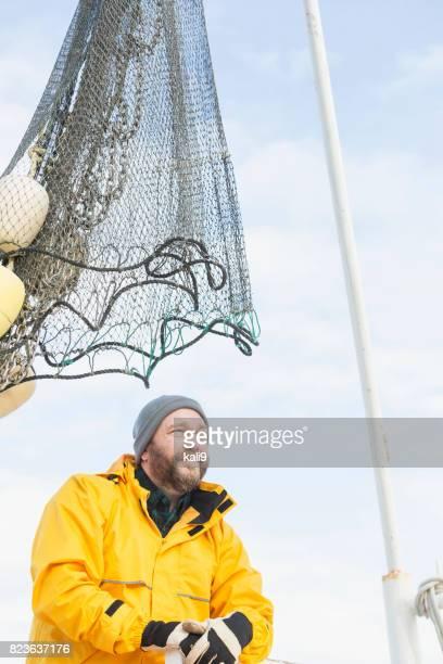 Man working on commercial shrimp boat