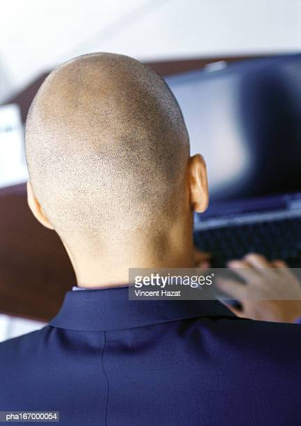 Man working on computer, rear view, close-up