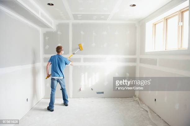Man working on drywall