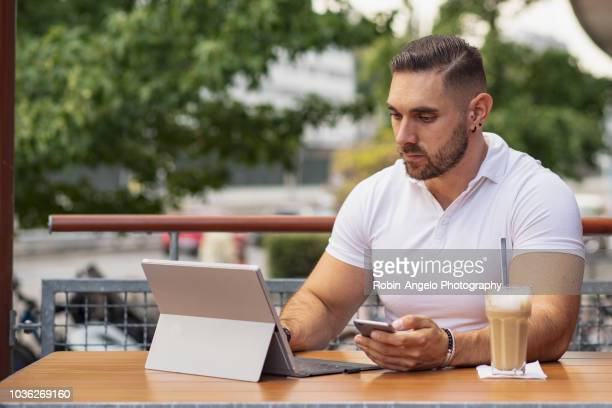 A man working on his laptop in a café