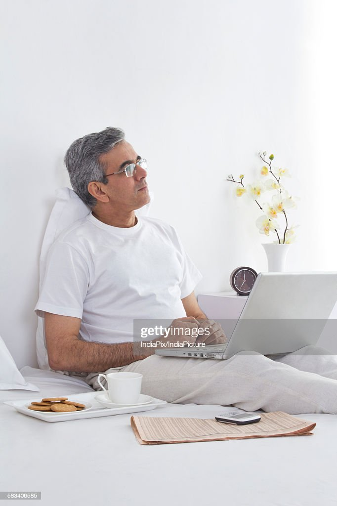Man working on his laptop : Stock Photo