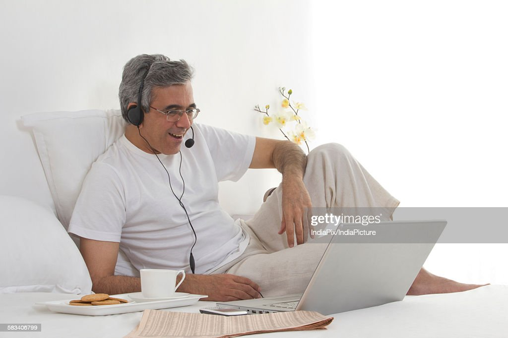 Man working on his laptop : Stock Photo