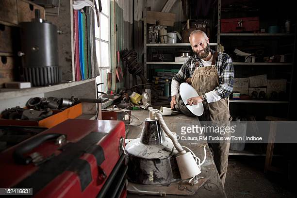 Man working on lamp in workshop