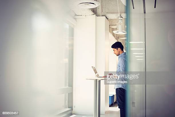 Man working on laptop computer in business office