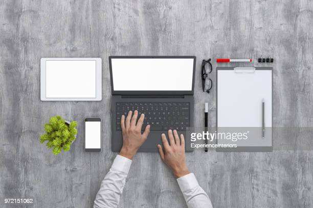 man working on laptop knolling overhead view - laptop mockup stock photos and pictures