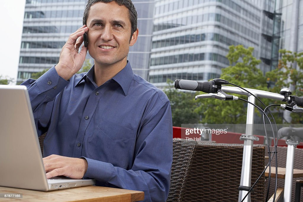 Man working on laptop outside : Stock Photo