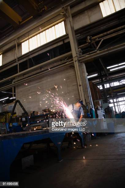 Man working on metal and creating sparks