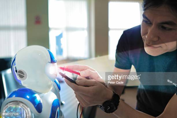 Man working on robot