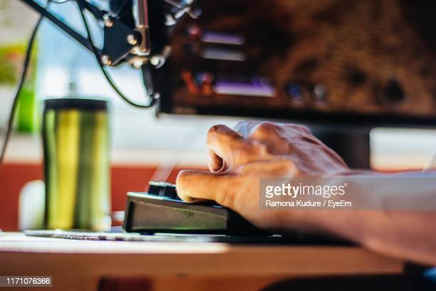 man working on table - esport stock pictures, royalty-free photos & images