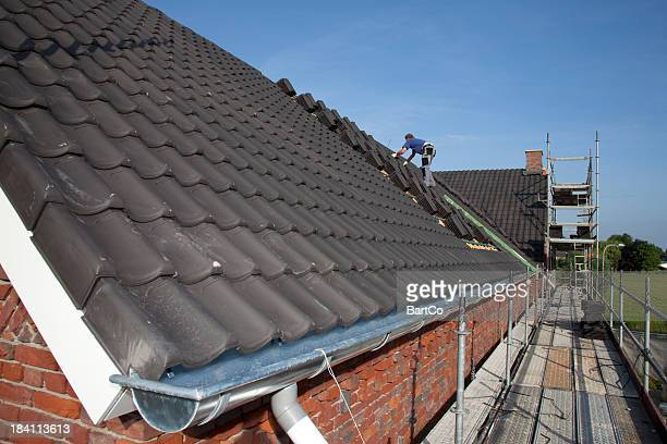 Man working on the roof.
