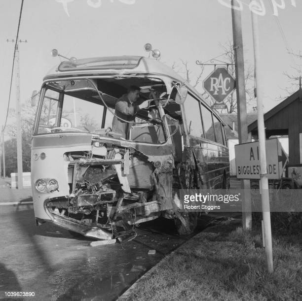 A man working on the wrecked bus of Sheffield Wednesday FC which crashed near Huntingdon A1 on the return trip from London injuring player Dougie...