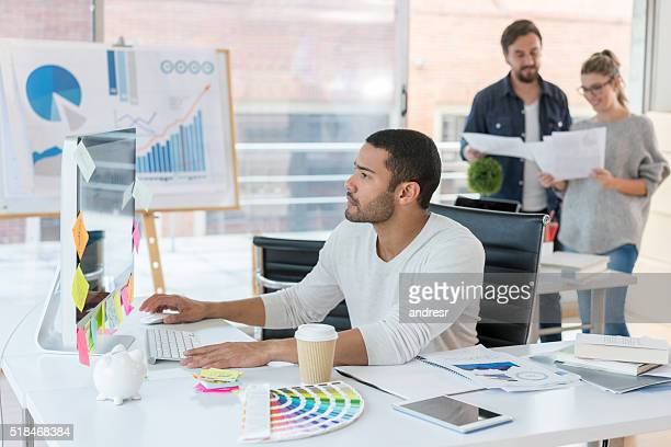 Man working online at a creative office