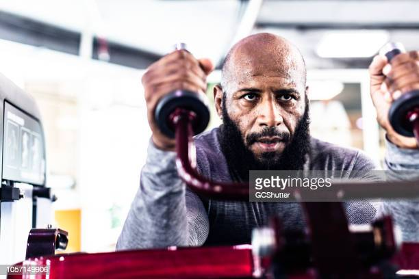 man working out at a fitness center - effort stock pictures, royalty-free photos & images