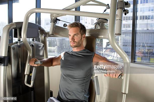 man working out in gym - エクササイズ用具 ストックフォトと画像