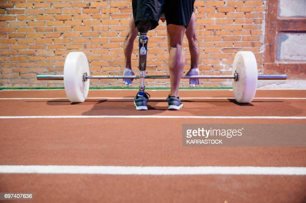 man working out in the gym - adaptive athlete stock pictures, royalty-free photos & images