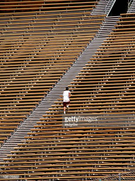 Man Working Out On Bleachers