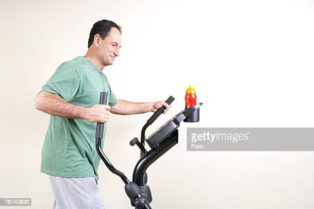 Man Working Out on Ellipitical Trainer