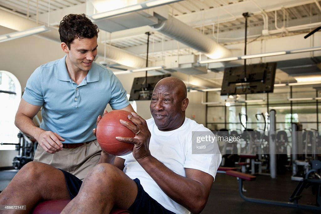 Man working out with fitness ball : Stock Photo