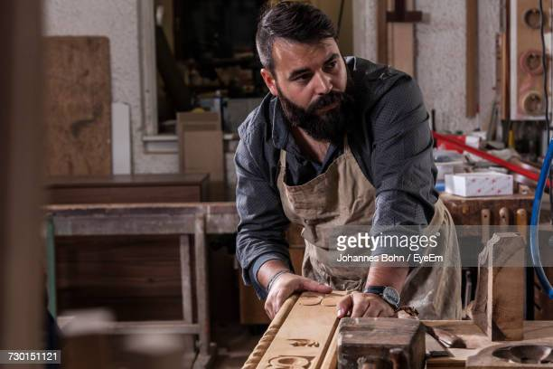 man working - carpenter stock pictures, royalty-free photos & images