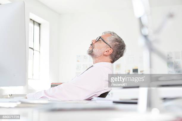 Man working relaxing at his desk in an  office