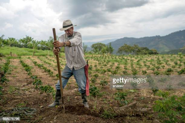 Man working the land at a farm – agriculture concepts