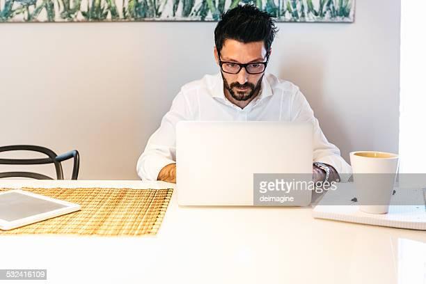 Man working using laptop at home